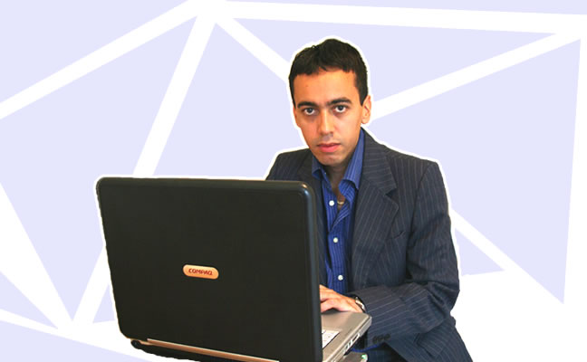 Alex Aranda sitting in front of a computer